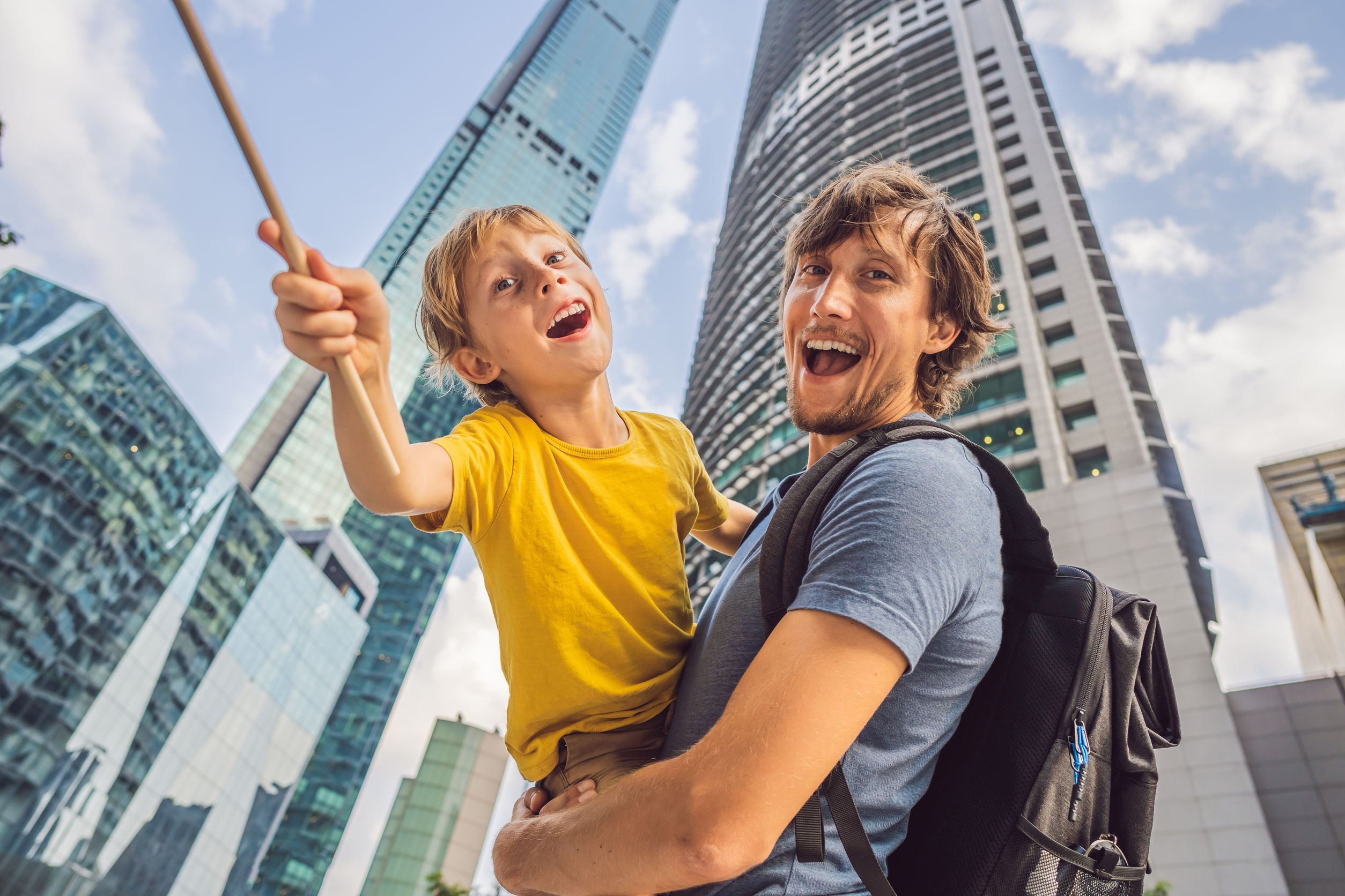 dad and son happy in city